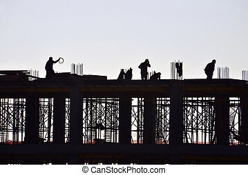Silhouette of people working and building construction