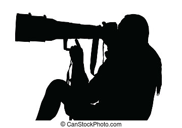Silhouette of Photographer Sitting with Large Lens on Monopod