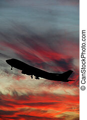Silhouette of plane and sunset