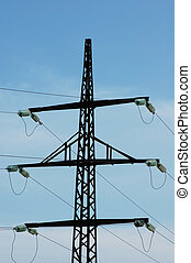 Silhouette of power line against bright blue sky