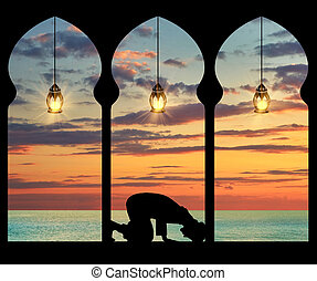 Silhouette of praying Muslim - Concept of the Islamic...