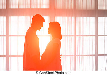 silhouette of pregnancy couple