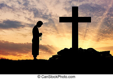Silhouette of priest and cross - Concept of religion....