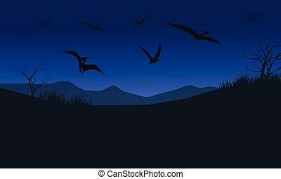 Silhouette of pterodactyl at night