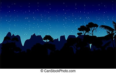 Silhouette of rain forest at the night scenery