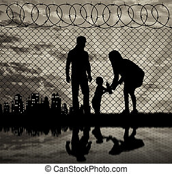 Silhouette of refugee families - Concept of the family of...