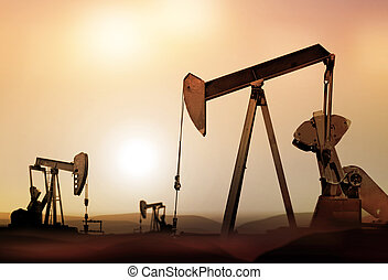 silhouette of retro oil pumps