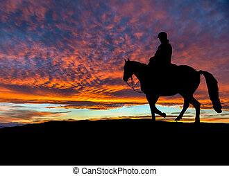 Silhouette of Rider on Horse at Dramatic Sunset