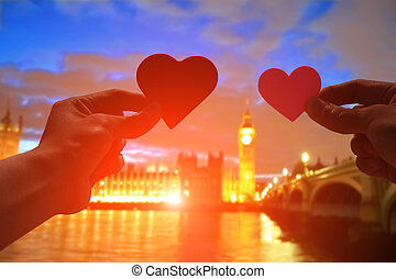 silhouette of romantic lovers hand