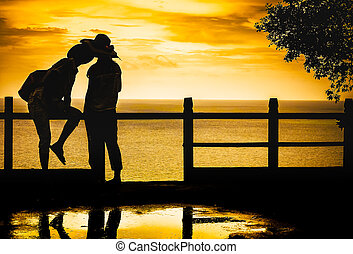 Silhouette of romantic lovers on seascape backgrounds, love concept
