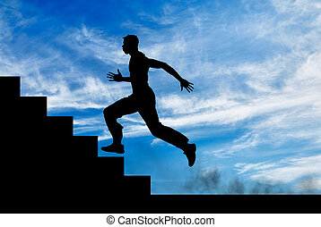 Silhouette of runner on the stairs up
