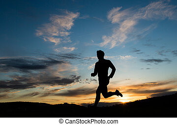 silhouette of runner