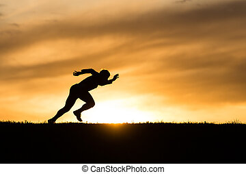 silhouette of runner
