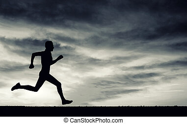 Silhouette of running man on cloudy sky. Black and white. Elemen