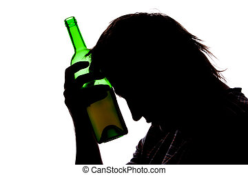 Silhouette of sad man drinking alcohol