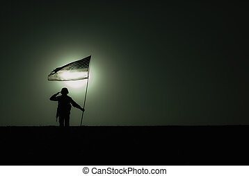 Silhouette of saluting US army soldier with flag