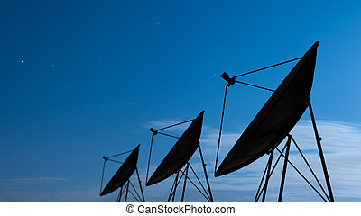 satellite dish - Silhouette of satellite dish in night sky