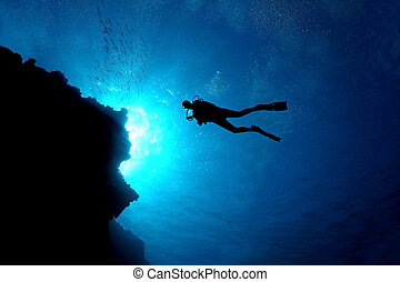 Silhouette of Scuba Diver Over a Coral Reef - Cozumel Mexico...