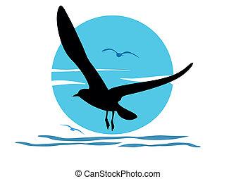 Silhouette of seagull on sea sunris