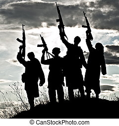muslim militants - Silhouette of several muslim militants...