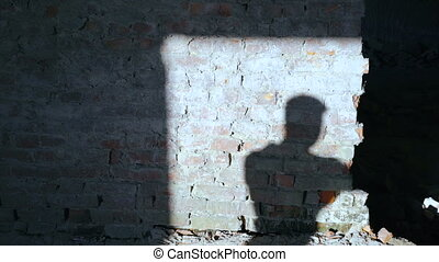 Silhouette of shadow of kickboxer doing exercise for the big fight in catacomb