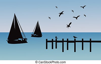 Silhouette of ship and pier