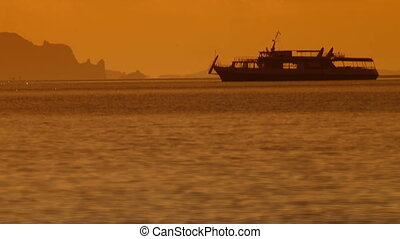 Silhouette of Ship At Sunset