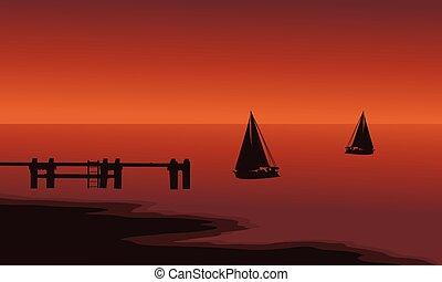 Silhouette of ship in beach