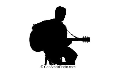 Silhouette of sitting man playing the guitar on a white background