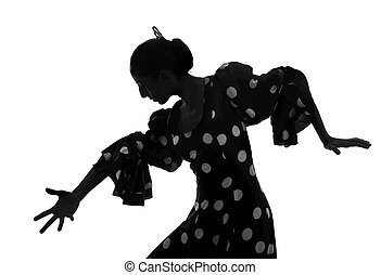 Silhouette of Spanish woman Flamenco dancer dancing...