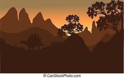 silhouette of stegosaurus in hills