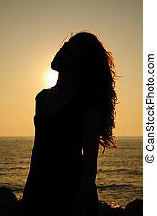 silhouette of sunset girl