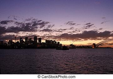 Silhouette of Sydney Skyline at dramatic sunset