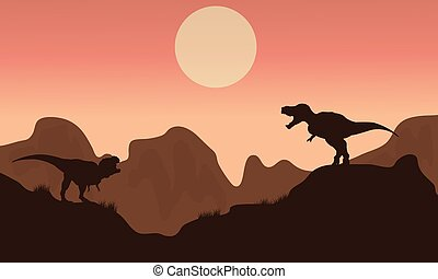 Silhouette of T-rex in cliff with sun