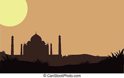 Silhouette of Taj Mahal in the fields