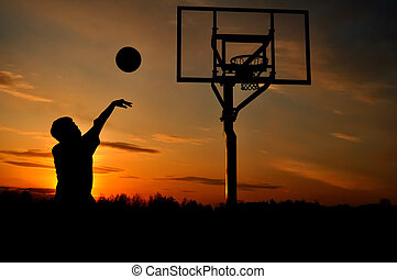 Silhouette of Teen Boy shooting a Basketball - Silhouette of...
