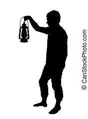 Silhouette of teenage boy holding up lantern - Silhouette of...