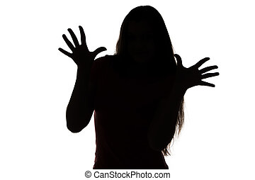 Silhouette of teenage girl with palm and fingers