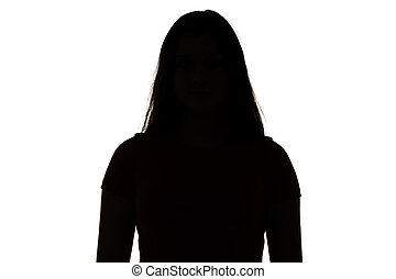 Silhouette of teenager looking at camera