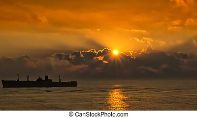 silhouette of the ancient ship at sunset, closeup