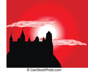 Silhouette of the castle on a high hill at sunset