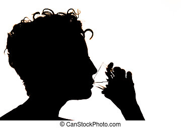 Silhouette of the girl drinking water