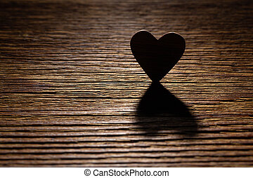Silhouette of the heart on a wooden board.