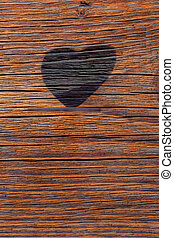 Silhouette of the heart on a wooden board