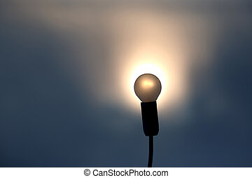 silhouette of the light bulb in setting sun