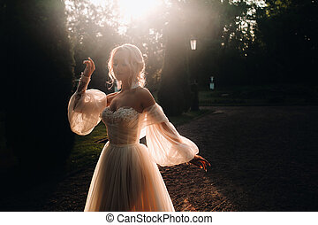 Silhouette of The lonely bride in the vintage At sunset