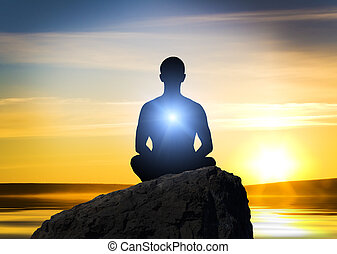meditation - Silhouette of the meditation person against a ...