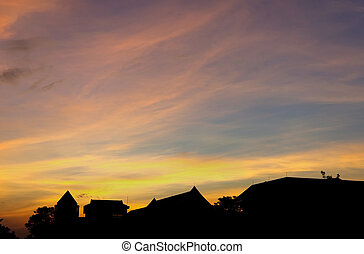 Silhouette of the roof office building at dusk with sky.