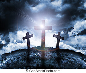 Silhouette of three crosses on a hill with a moon behind them