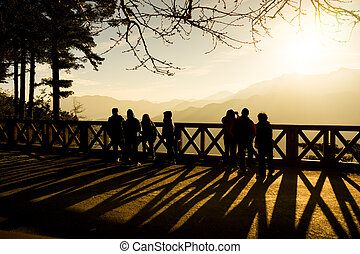 Silhouette of tourist watching sunrise at Chu Shan viewpoint
